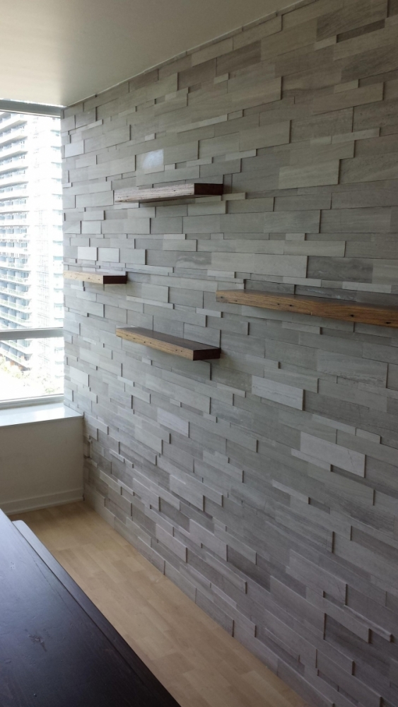 Installation of Silver Fox Erthcoverings Wall Feature
