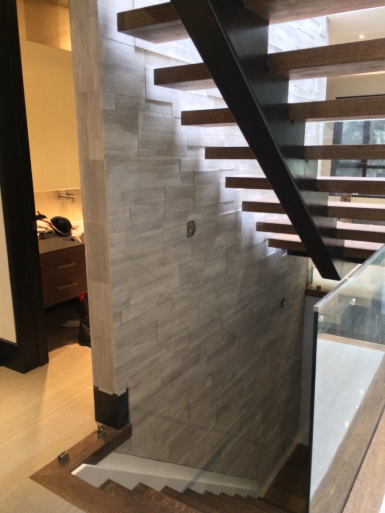 Staircase Install of Silver Fox Erthcoverings