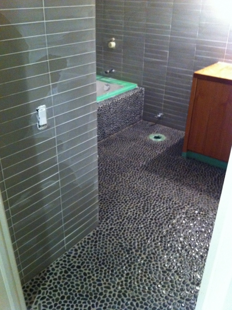 Stone Tile Glass Tile and Charcoal Pebbles Erthcoverings Installation